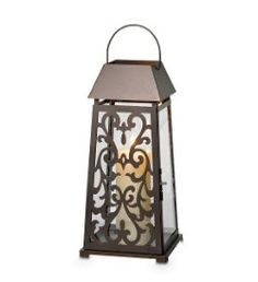 Brand new GORGEOUS PartyLite lantern.  Change the magnetic panels for the season!  www.partylite.biz/Chrisg