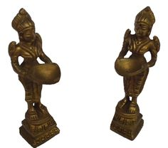 <b>Content: </b> Lady Holding Welcome Lamp Set of 2 Brass Diyas<br> <b>Dimensions: </b>9 cm Height<br>  <b>Material: </b>Brass  <br>