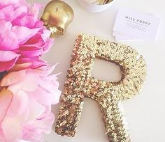 Glue sequins to wooden letters or words. Spray paint skull candle gold, silver, etc