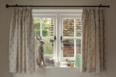 A tape heading, this pretty heading is popular for cottage windows and can have a standup to give a floppy top. Suitable for track or pole. In this photo we have used mini hares linen with a dainty gingham cotton as the lining to add some extra detail.