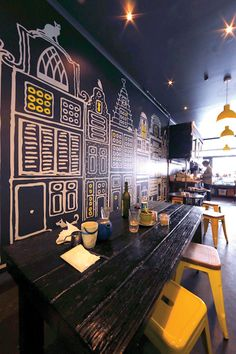 Graphic art adorns the walls of Torch cafe in Melbourne, designed by Henrietta Reed. Photo by Bruce Lindsay