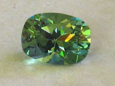 Gemstone Photographs - Demantoid Garnet.  This pic gives just a hint of the incredible light show these stones produce.