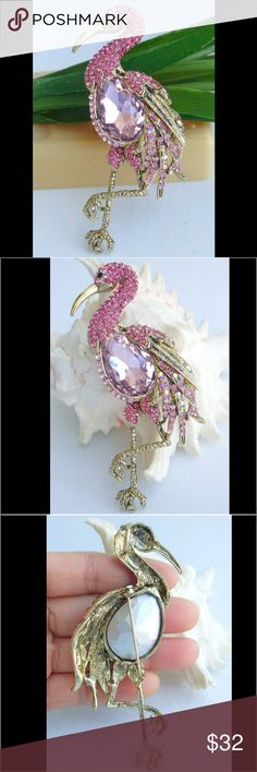 """Unique Crystal Flamingo Animal Brooch Rhinestone Crystal Flamingo Brooch. Main stone color: Pink Metal Base Color: Yellow golden tone plated Metal: Zinc Alloy Main Stone:Austrian Rhinestone Crystal Length: 10.0cm(3.94"""") Width: 3.5cm(1.38"""") 100% Brand New and in excellent condition ready for gift-giving Jewelry Brooches"""