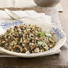 Wild Rice Pilaf | Lightly coating rice with butter or oil before adding the broth prevents the grains from sticking together. Less liquid is used during slow cooking because it doesn't evaporate as quickly as when cooking rice on the stovetop. #Thanksgiving