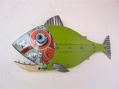 Fish made with Wood, Metal,Glass, Handmade by Unikos Arts Give your wall beach steampunk theme with one of a kind original Fish wall art sculpture. Hanging point provided at back for ease of wall hanging Dimensions D x W x H 7 in Fish Wall Art, Fish Art, Metal Fish, Wood Fish, Steampunk Theme, Seaside Art, Fisherman Gifts, Fish Sculpture, Scrap Metal Art