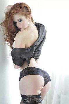 Stunning redhead beauty in lingerie and thigh highs. I know it's not Thigh High Thursday, but that's ok.