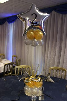 Numbered balloon table centres with mask theme Venetian masquerade