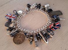 'I Am Sherlocked' Charm Bracelet- like if you wish you had one!!!!! Considering making my own...