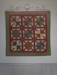 A  Jo Morton l made awhile ago...got to love  mini quilts, you actually can finish them!!