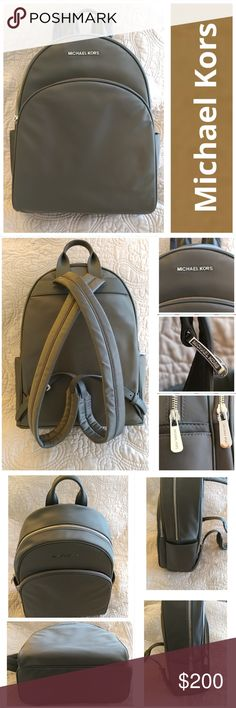 🆕 NWT Michael Kors Lg Abbey BackPack NWT Michael Kors Abbey Backpack  Color: Graphite  Nylon w/leather accent at top handle and straps  Zip-around closure.  Adjustable shoulder straps.  Exterior zip pocket.  Interior zip, wall and cell-phone pockets; key clip.  Logo-jacquard lining.  Excellent condition.  Never used.  Smoke free home. LOC CL7 Michael Kors Bags Backpacks