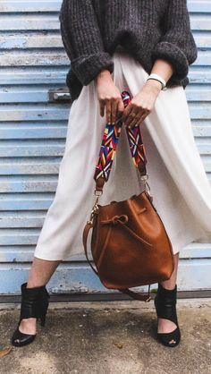 Fashion Me Now in a guitar strap bucket bag