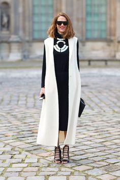 Love the long contrasting waistcoat/sleeveless jacket