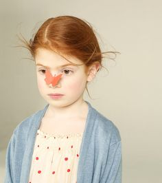 Young redhead girl with a pink butterfly on her nose. Kidspiration by Femke Reijerman - Carefully selected by Gorgonia www.