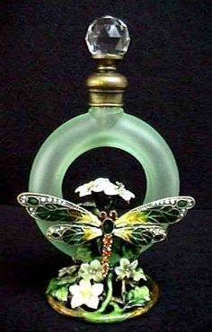Glamour girls love beautiful perfume bottles to grace their vanities. Ooh la la! (Ann Primrose Murano Cristalleria Collection Perfume Bottle w/Flowers & Dragonfly)