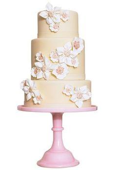 blush fondant wedding cake with white gum paste flowers