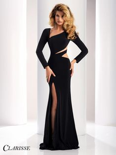 Sheer cutouts inset the full back and sweep asymmetrically across the waistline of this Clarisse 4859 black evening dress with an asymmetrical neckline. This full-length gown features long sleeves and the fitted skirt has a mid-thigh side slit and a sweep train. #clarisse #promdresses #prom #prom2018