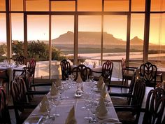 Blowfish: Modern restaurant with a focus on fish and sushi, offering views of Table Mountain and the bay. Modern Restaurant, Restaurant Tables, Big Bay, Photo Supplies, Table Mountain, Beach Hotels, Wedding Locations, Cape Town, The Good Place