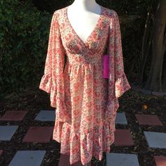 Betsey Johnson Gypsy Dress Size 2 NWT Betsey Johnson Gypsy Peasant Dress, size 2, beautiful bell sleeves, zipper closure, lined, empire waist that ties in back. NWT Betsey Johnson Dresses