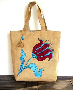 Handmade jute  τote bag with a blue whimsical flower by Apopsis,