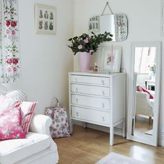 Create a relaxed dressing area in your bedroom with a comfy armchair and full-length mirror. Pastel colours and pretty florals give it a country feel.