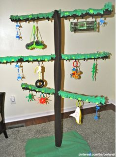 Sugar Glider Play Tree. Made of PVC piping, wooden base and fleece fabric. Toys made by hand or bought added to small tabs on branches! Great addition for any glider room! https://www.pinterest.com/barberians/