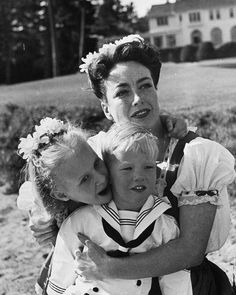 Joan Crawford hugging her two adopted children, Christina & Christopher. Phoney as they come. Joan was Mommie Dearest.