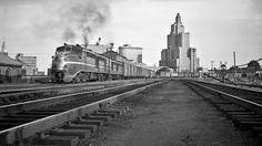 NH, Providence, Rhode Island, 1954 New York, New Haven and Hartford Alco DL-109 leading a freight train past Providence, Rhode…
