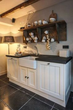 Love the farmhouse sink with the white cabinets & dark countertop. And the floor. Love the farmhouse sink with the white cabinets & dark countertop. And the floor. Love the farmhouse sink with the whi. Country Kitchen Shelves, Farmhouse Sink Kitchen, Rustic Kitchen, New Kitchen, Farmhouse Cabinets, Space Kitchen, Rustic Shelves, Country Farmhouse, Cozinha Shabby Chic