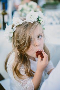 sneaky flower girl // photo by Paige Jones // http://ruffledblog.com/romantic-oregon-riverside-wedding
