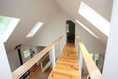 A interior view from the catwalk, photographed Aug. 27, 2012, showing the main room of the Putnam Valley lakeside home designed by architect Annette Lindbergh, who runs a firm called Tiny Houses with her husband, L.R. Lindbergh. ( Joe Larese/The Journal News )