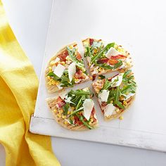 Grilled Corn and Bacon Pizzas with Baby Arugula  Meet your new favorite pizza topping.  Get the recipe from Delish.