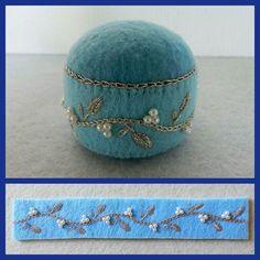 Felt pin cushion.  My work.  Silver thread and pearl beads.