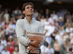 French Open 2014 /  SUNDAY, JUNE 8, 2014 - MEN'S FINAL - TROPHY CEREMONY:  The Spanish national anthem resounds around Philippe Chatrier Court. Rafael Nadal can't hold back the tears. Sunday, June 8, 2014.