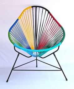 This chair is hot! Originally designed in Acapulco Mexico, circa 1950. Designer Carlos Ocho of Mexico City manufactures the Acapulco Chair today. Made with a powder coated iron frame and vinyl cord, each item is crafted entirely by hand a few miles outside of Acapulco, ensuring its charm, character; and most important, authenticity.