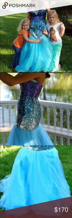 Prom dress This beautiful mermaid style prom dress. With a sweetheart neckline covered in gems, then the body goes into a ombré blue with sequins! Then the bottom is made with tulle . Got it as a size 6 had it altered to a 4. There is a small tear at the very bottom of the tulle, but if you get it hemmed more it will be taken off! I had it hemmed for myself but it was still on the long side and I'm 5'2. Which is how the small tear happened my shoe stepped on it. Made me feel like a mermaid…