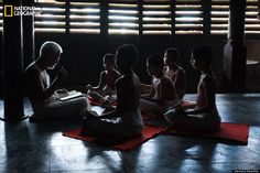 "Enlightenment  ""The teacher imparting ancient India scriptures, Rig Vedas to the students of the 400 year old Vedic Research Center of Kerala, one of the oldest in India. The teaching is done by traditional means of chanting and actions by hand and not by books. The student's look at the way the teacher is chanting and memorizes the method. more >>>  Location: Trissur, Kerala, India.  Photo and caption by Sreeranj Sreedhar/ National Geographic 2014 Photo Contest."