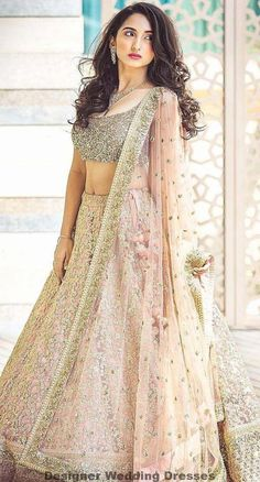 Indian wedding dresses are very beautiful. Usual indian bridal dresses made of chiffon or silk and adorned with elaborate embroidery, red or gold color. Indian Bridal Lehenga, Indian Bridal Outfits, Indian Bridal Wear, Indian Dresses, Bridal Dresses, Shaadi Lehenga, Net Lehenga, Indian Wedding Clothes, Indian Wear