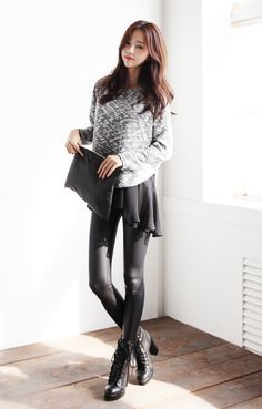 Love the winter look of the grey sweater, black skirt, black tights, black ankle boots, and black clutch.