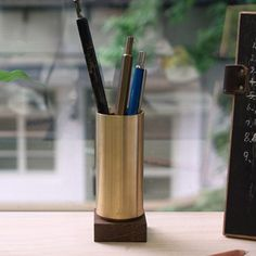 Ystudio at Another Country Pen Container: The pen container is cut from a brass cylinder, as well with the hand wrought wenge-wood base.  Crafted in Taiwan by ystudio.