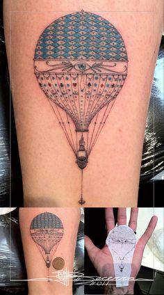 hot air balloon micro tattoo