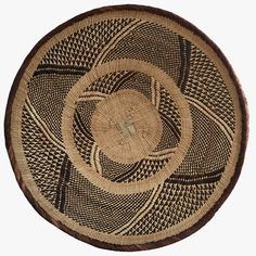 Our Large Tonga Basket IV is made in the Binga district of Northern Zimbabwe from all natural and locally harvested materials such as wild grasses.