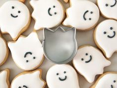 Use a tulip cookie cutter to craft cute ghost cookies. Oscar would love these. And I'd eat some too! :)