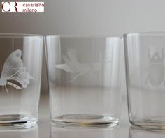 Glasses engraved by Murano glassblower. Versatile use, for drinking or serving ice cream, fruit salads, puddings, cold soups or any appetizer .Themes: SEA, SNOW, HUNT, INSECT, JUNGLE and the matching carafe.