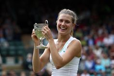 Eugenie Bouchard holds the trophy after defeating Elina Svitolina in the Girls' final. - Steve Wake/AELTC