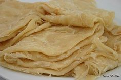Here in the Caribbean when we talk about roti, we refer primarily to three types: paratha (oil roti, buss-up-shut), sada roti or dhal puri. Roti Paratha Recipe, Paratha Recipes, Roti Recipe Guyanese, Roti Skin Recipe, Jamaican Roti Recipe, Carribean Food, Caribbean Recipes, Trinidad Roti, Guyana Food