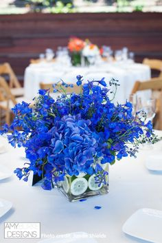 This table reception arrangement is so bright! If you love blue this is perfect for a wedding! #summerwedding @janaeshields Location Thomas Fogarty Winery