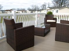 Fensys plastic UPVC garden decking with bowed white picket spindles and premium excel tawny deck boards Plastic Fencing, Decking Suppliers, Caravan Holiday, Led Manufacturers, Building A Deck, Park Homes, Outdoor Furniture Sets, Outdoor Decor, Small Gardens