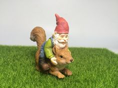 Gnome riding on squirrel