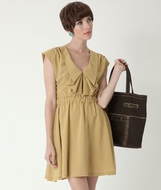 Charming mustard yellow dress with a ruffled flounce on the neckline and a full skirt.