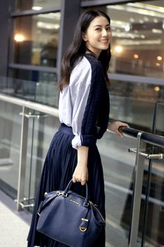 Gao Yuanyuan wearing Michael Kors Riley bag. April 2015